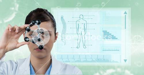 Female doctor holding molecular structure with medical report in background