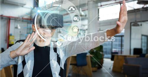 Digital composite image of woman using VR glasses in office