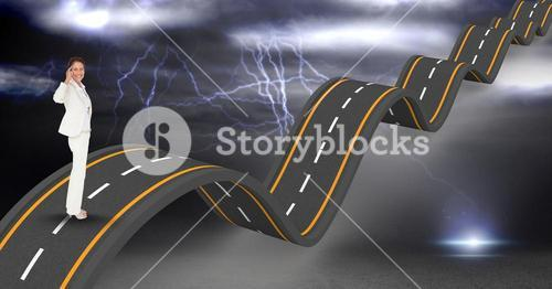 Confident businesswoman on wavy road during thunderstorm