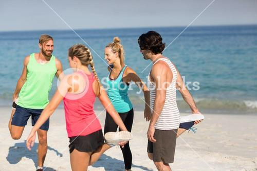 Friends exercising at beach
