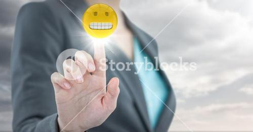 Business woman mid section with flare against cloudy sky
