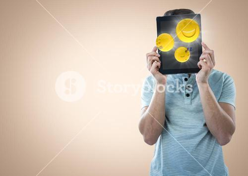 Man tablet over face showing emojis with flares against cream background