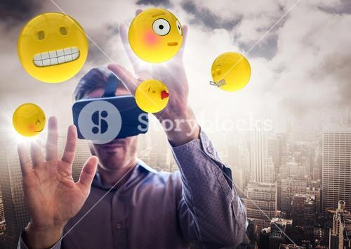 Man in VR with hands up touching flares and emojis against skyline and clouds
