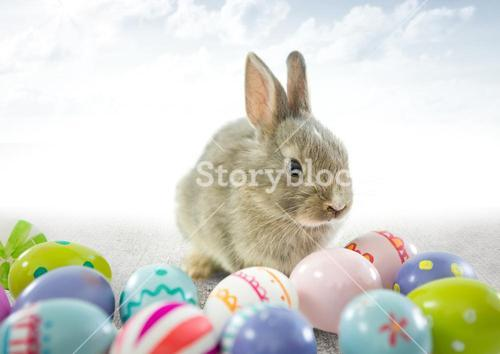 Easter rabbit with eggs in front of cloudy sky
