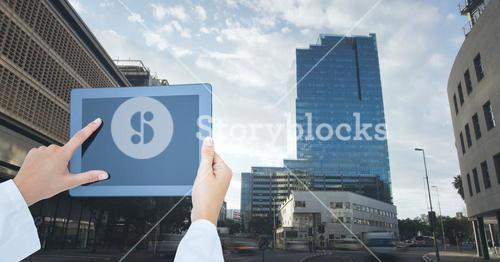 hands with tablet in the city