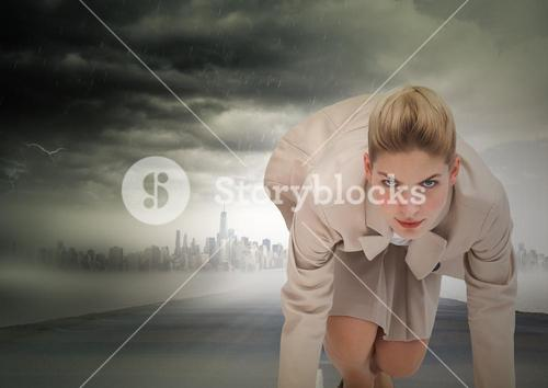 Business woman at start line on road with skyline and storm
