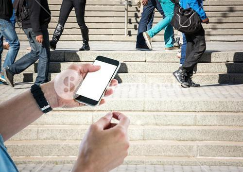 Men hands with phone in stairs