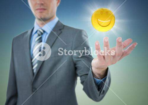 Business man with hand out and emoji with flare against blue green background