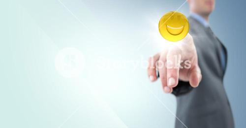 Business man pointing at emoji with flare against blue background