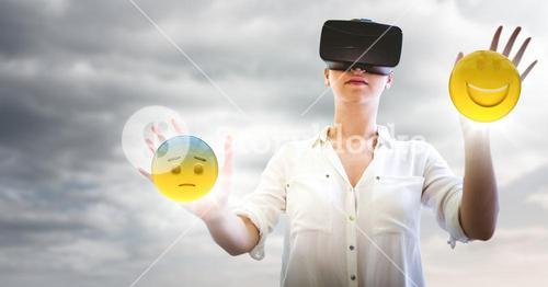 Woman in VR with network and emojis with flares against cloudy sky