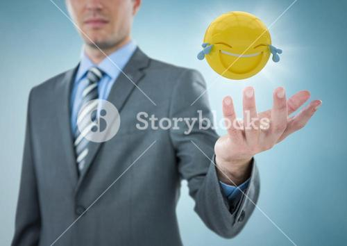 Business man with hand out and emoji with flare against blue background