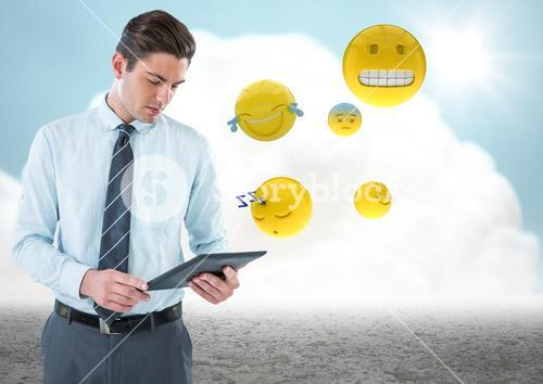 Business man with tablet and emojis against cloud and ground