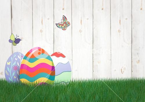 Easter color eggs with butterfly in the garden