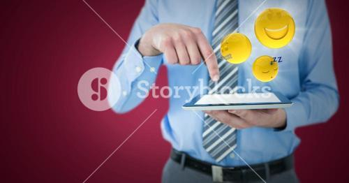 Business man mid section with tablet and emojis with flares against maroon background