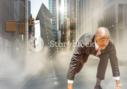 Business man at start line on arrow shaped road in street with flares