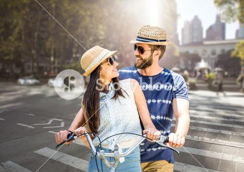 Couple with the bike in the city