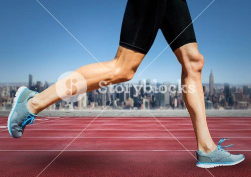 Runner legs on track against skyline