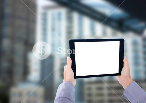 hands with tablet in the bus station
