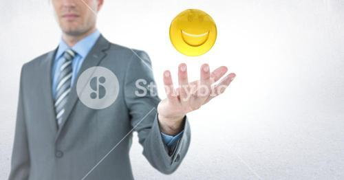 Business man with hand out and emoji with flare against white background