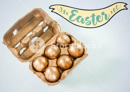 Easter banner and gold eggs in carton against white background