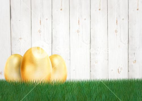 Three gold eggs in the garden. Happy Easter.