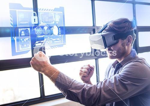 Man punching the air wearing VR Virtual Reality Headset with Interface
