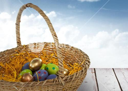 Easter eggs in basket in front of blue sky