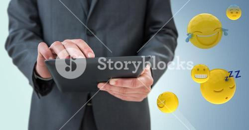 Business man mid section with tablet next to emojis and flare against blue background