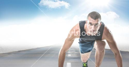 Male runner on road against sky and sun with flare