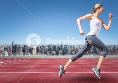 Female runner going on track against skyline