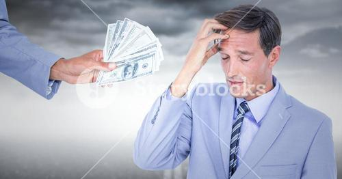 Business man refusing money against stormy sky