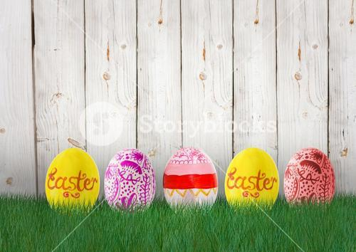 Easter yellow, orange and pink eggs in the garden