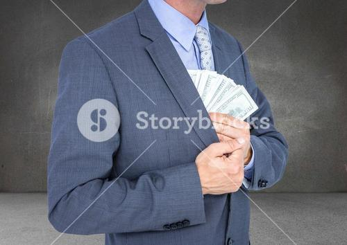 Business man mid section putting money away against grey wall