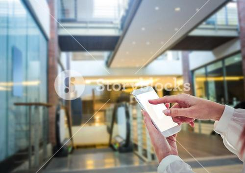 women hands with phone in shopping centre