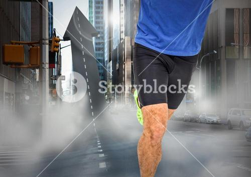Male runner legs on arrow shaped road in street