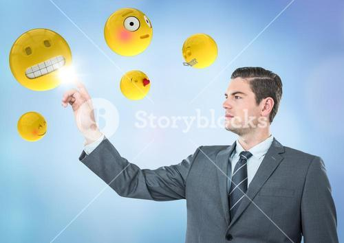 Business man pointing at emojis against blue background