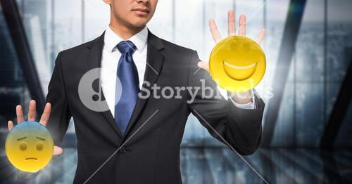 Business man mid section with flares and emojis on hands against dark blurry window