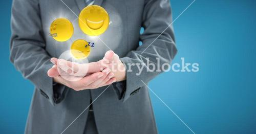 Business man mid section with hands together and emojis with flares against blue background