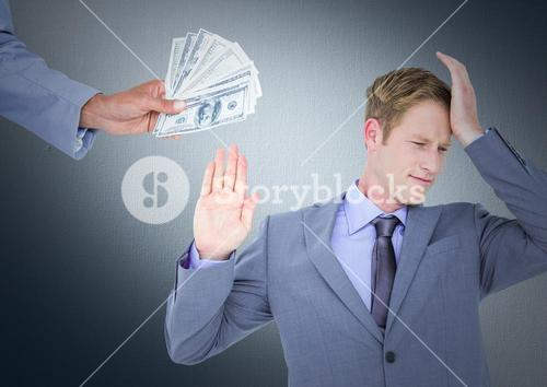 Business man refusing money against navy background