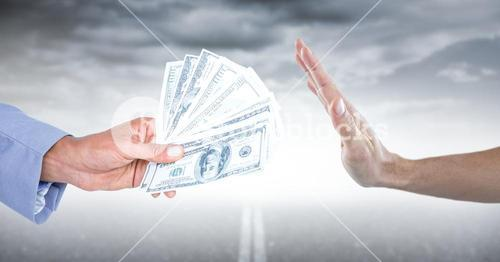 Hand refusing money against road and stormy sky