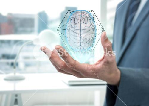 Brain with hexagon graphic in the hand of a business man