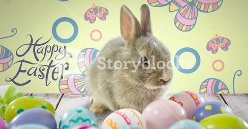 Happy Easter text with Easter rabbit with eggs in front of pattern