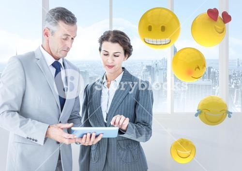 Business people with tablet against window and emojis