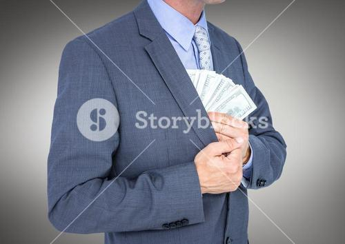 Business man mid section putting money away against grey background