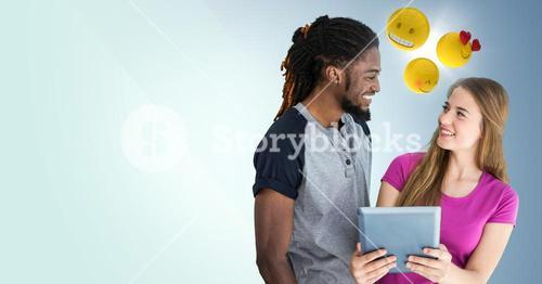 Man and woman with tablet and emojis against blue background