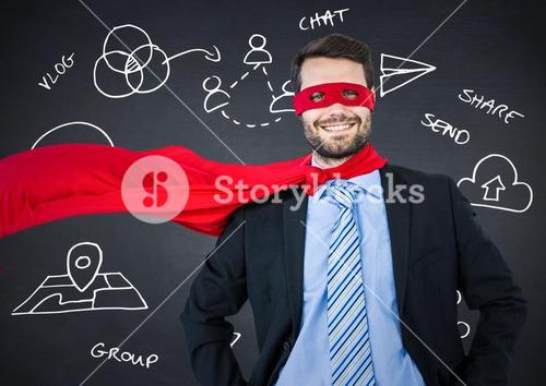 Business man superhero with hands on hips against navy chalkboard with white business doodles