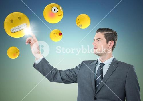 Business man pointing at emojis against blue green background