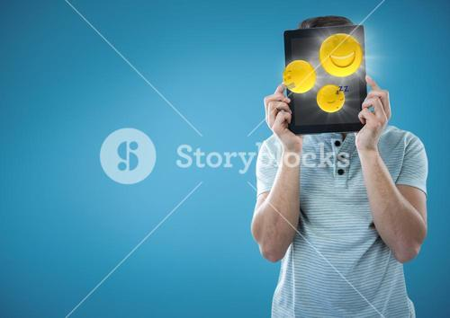 Man tablet over face showing emojis with flares against blue background