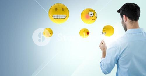 Back of man with emojis and flare against blue background