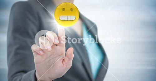 Business woman mid section with flare against blurry grey wood panel